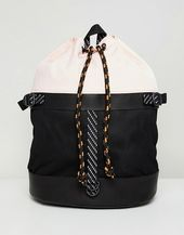 DESIGN duffel backpack in pink and black mesh with internal laptop pouch