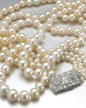 An impressive three-row natural pearl and diamond …