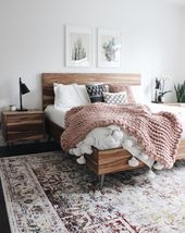 Modern boho bedroom with white walls and chunky bl…