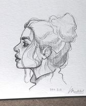 Photo of My sketchbook art drawing girl female face …