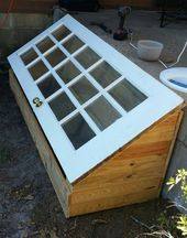 A green house made using a old 15-Lore/windowpane door. ~ DIY greenhouse #WoodPr…   – garden-details and examples of how to…