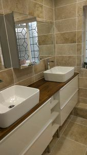 Bathroom is ready! Natural stone travertine tiles, oak worktop and double sinks …