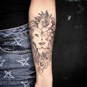 Lion tattoo + Flowers on the forearm