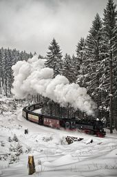 Steam train in the snow by Jörn Hoffmann.
