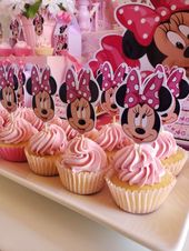 Don't miss the cute cupcakes at this lovely pink Minnie Mouse birthday party! Se…