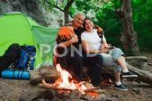Tent camping couple romantic sitting by bonfire night Stock Photos #AD ,#couple#…