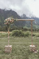 Rustic ceremony backdrop with stunning mountain views | Image by Hayley Williams…