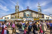 Big beer tent. Oktoberfest, Munich: One of the big beer tents. In the foreground…