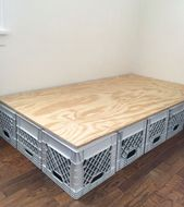 Photo of Bed base made of plastic crates.