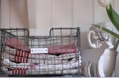 wire basket: kitchen linens…. Like this idea instead of a drawer that hides be…
