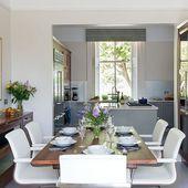 Open-plan white and walnut kitchen-diner