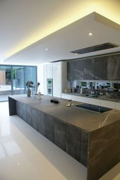 High gloss oyster white and pietra stone fronted kitchen. orcadesignltd.com