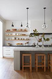Open kitchen shelves // industrial pendant lights // hardwood floors // floating shelves