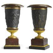 A matched pair of Louis XVI ormolu-mounted patinat…