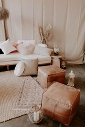 Modern, Earth Tone, Moroccan Inspired Lounge with Leather Poufs & Layered Rugs