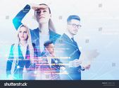 Team of inspired young business people over blurred background with double exposure of network interface and lines of code. Concept of technology in b…