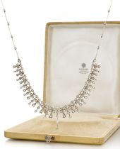 A FABERGÉ SILVER-TOPPED GOLD MOUNTED DIAMOND NECK…