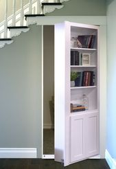 Great place for a hidden door!  . What's under your stairs?