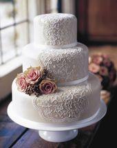 einzigartige Vintage-Hochzeitstorte mit weißer Sp…