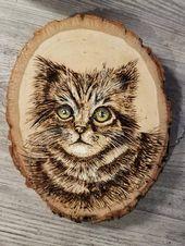 Cindy: Wood hat Kitty verbrannt – Brandmalerei
