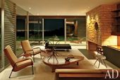 a cozy mid-century modern living room with a firep…