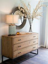 dekorieren sideboard zweige blueten weiss elegant lampe kommode metall gestell