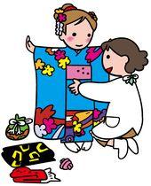 七五三のお祝いの形はさまざま 着付けをしてもらう女の子 ドレスの少女