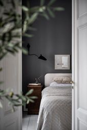 Bedroom with dark grey walls in Swedish home / Lovisa Häger