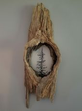 Crafts with natural materials, branch with a painted plastic disc as a wall decoration …