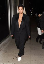 Kim Kardashian flashes major cleavage in blazer and trousers set