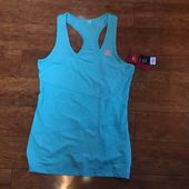 NWT FILA Sport Running Shirt NWT FILA Sport Blue Running Shirt. Size L. 88% Polyester 12% Spandex. Wicking technology draws moisture away from the bod…