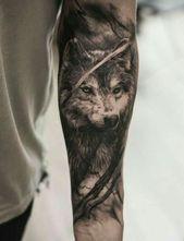 ein hand mit einem schwarzen wolf tattoo   tattoo wolf
