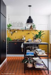 Reformed kitchen with mustard wall in rented aperitif with antique ceramic floor