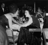 American actors Gloria Swanson and Corinne Griffith talk at a banquet…