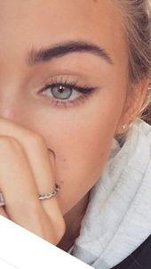 smoky eyes, bold lipstick and nail art. Beautiful, natural …