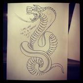 Mein Mann Roach sagte, es sei am besten, ein Schlangen-Tattoo auf dem Foto zu haben