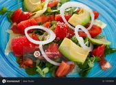 Fresh colorful salad with watermelon, ripe avocado, tomatoes, grapefruit and gre…