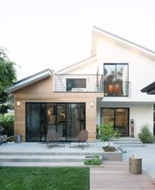Love the roof lines and the black/white/wood color scheme of this house.