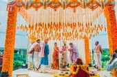 Photo of South indian mandap decor idea with orang…