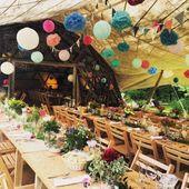 Wedding Festival Wedding Decor – wooden trestle tables, bright flowers, marque…