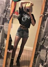 """Oversized """"Nirvana"""" band crop top, denim shorts, fishnet stockings & combat boot… – Outfits"""