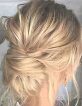 Perfectly Imperfect Updos You'll Love for Your Wedding: Low buns are a beautiful option for a little bit of a messy updo! #weddinghairupdos