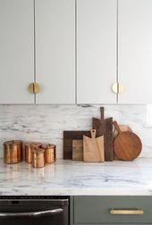 Modern kitchen, marble backsplash, brass hardware,…