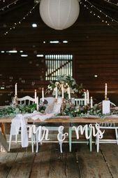 Perfect greenery and rustic barn woods wedding table! Perfect for a garden and b…