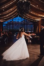 The couple shares their first dance at this rustic-inspired reception