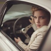 Same model, another look. Sophia behind the wheel of a classic car. The extreme …