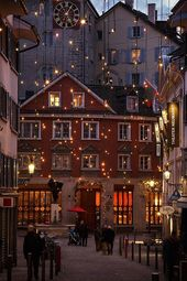 An alley in the old town of Zurich at night with C…