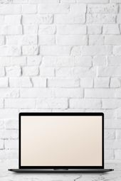 Download premium psd of laptop with screen mockup on a white marble table