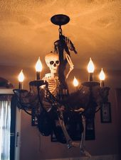Skeleton and creepy cloth on my dining room chandelier