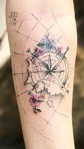 Schönes Tattoo am Arm. Weltkarte Tattoo. Ideal für Reisende – Künstler